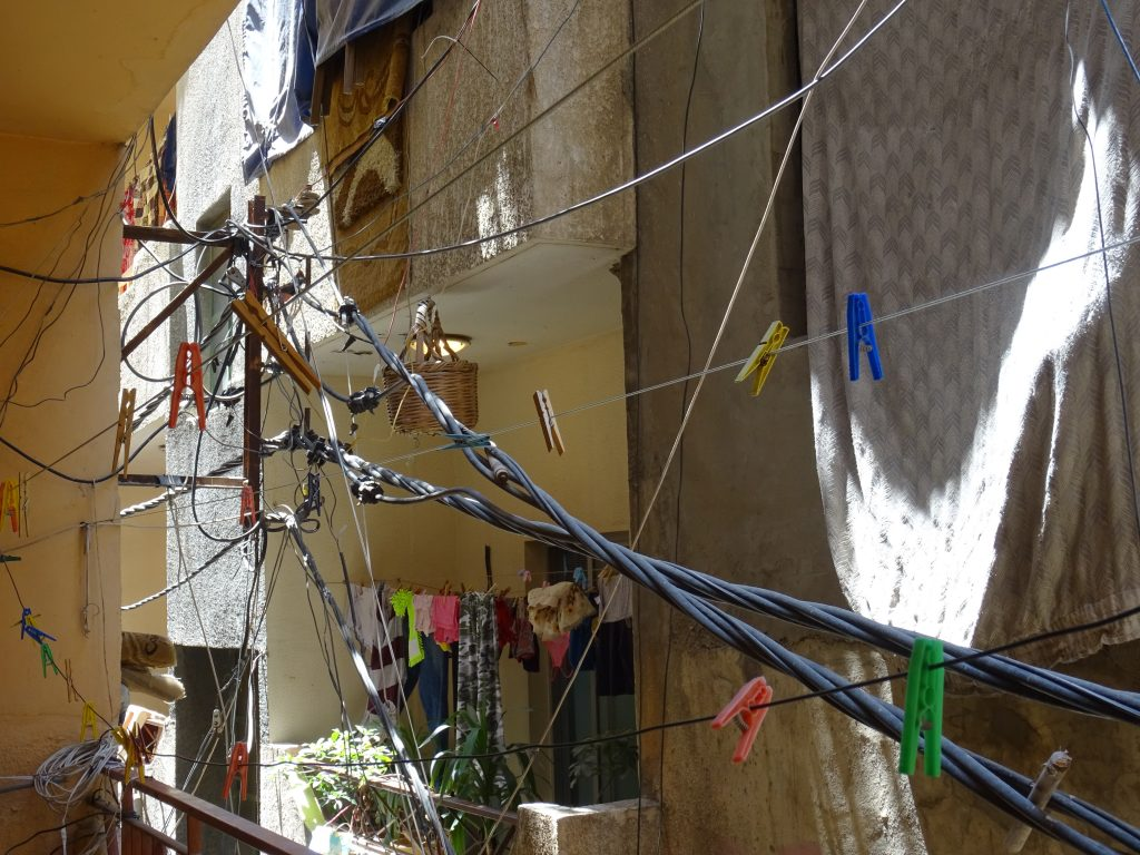 Making it work: electricity cables and clothes lines in Baddawi refugee camp, North Lebanon. Photo by Elena Fiddian-Qasmiyeh